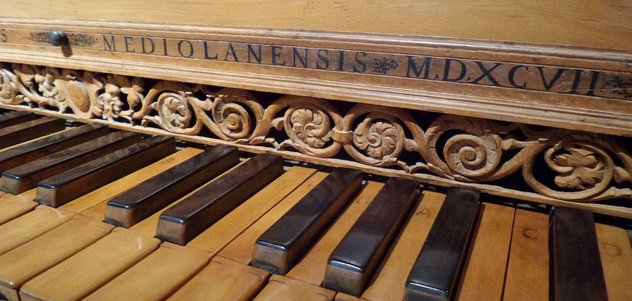 Our Services header image with a brown-keyed old piano